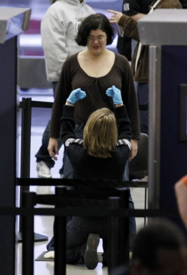 Texas Lawmakers AWOL For Vote On TSA Groping Bill tsa pats down passenger hare airport chicago
